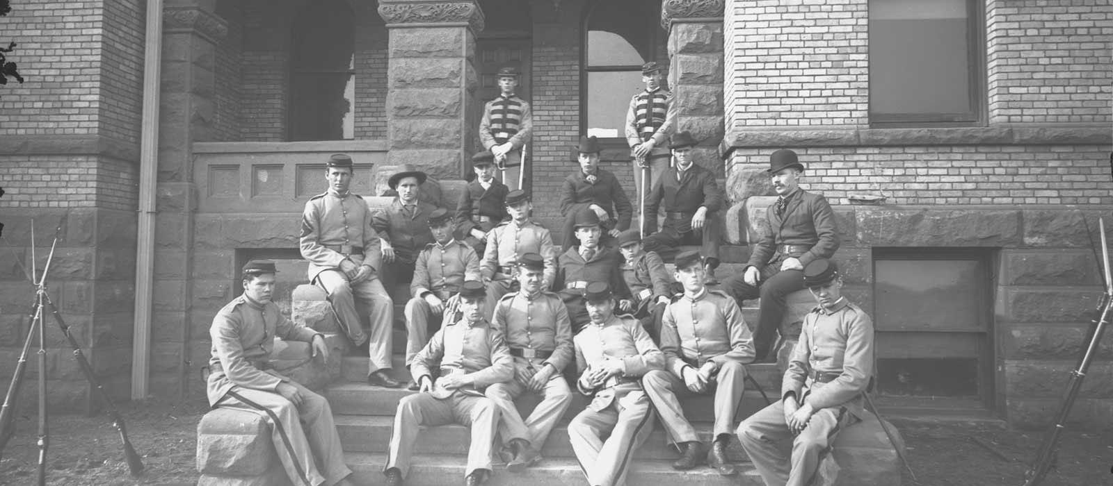 Cadets Leaning on Old Main - Fall